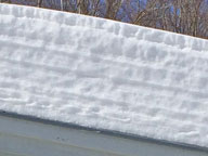 Layers of snow on the roof of the front portico at the Birch Ridge Inn, Killington