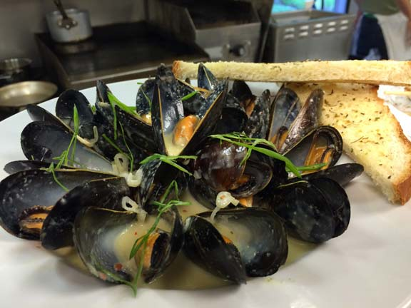Steamed PEI mussels in green curry coconut broth