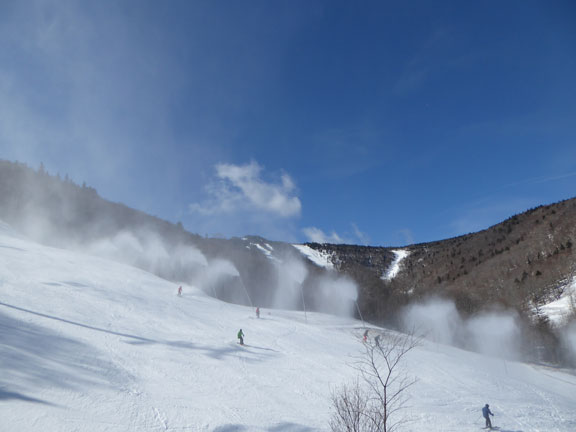 Snowmaking on Superstar with Killington Peak in the background.