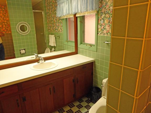 Old avocado tile bathroom in Room 2