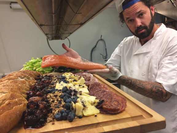 Chef Colin building party platters