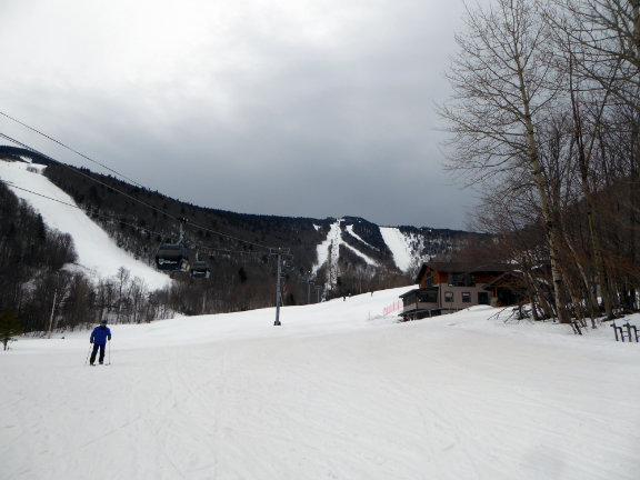 Foreboding clouds descend on Killington as Chuckles skates in front of K1 on way to Bubble