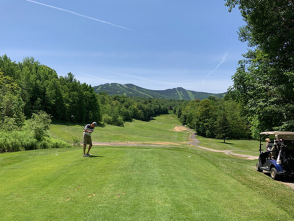 Golfing with the Bagel on the 16th tee at the Killington Resort Golf Course.