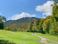 Color developing at Killington.  From 15th tee on Killington Golf Course looking towards Superstar and Skye Peak.